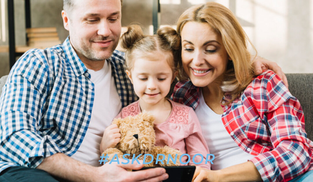 Family of three looking at cell phone